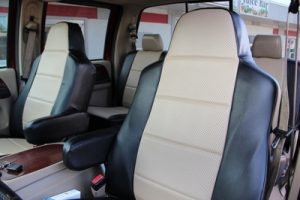 Tan and black custom seat covers for Fords