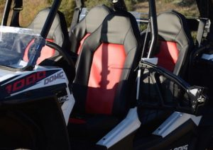 black and red seat covers on the trail